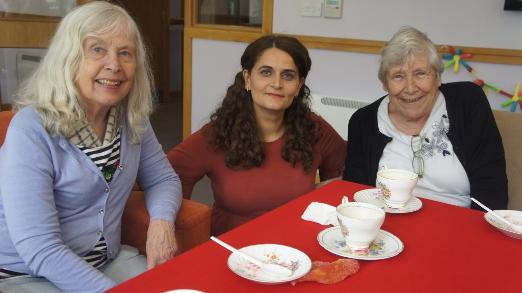 residential care homes- breakfast with elderly woman